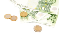 One hundred euro banknotes and coins Stock Image