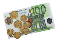 One hundred euro banknotes with coins isolated Stock Image
