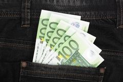 One hundred euro banknotes in a jeans pocket close-up.  Royalty Free Stock Photography