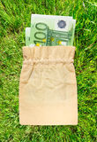 One hundred euro banknotes in linen sack Royalty Free Stock Photo