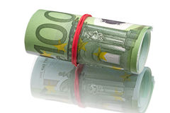 One hundred euro banknotes roll. With red rubber.  on white background Stock Photo