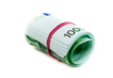 One hundred euro banknotes. Roll with rubber isolated on white Royalty Free Stock Image