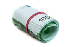 One hundred euro banknotes roll. With rubber isolated on white background Royalty Free Stock Photography