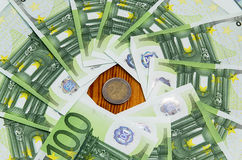 One hundred euro banknotes. With two euro coin Stock Photo