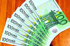 One hundred euro banknotes. On wooden table Royalty Free Stock Photo