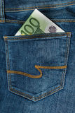 One hundred euro in the jeans pocket. One hundred euro banknote in the jeans pocket Royalty Free Stock Photography
