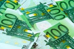 One hundred euro nominal banknotes. Lying mixed background Stock Photos
