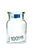 One hundred euros in a glass jar, on a white background Royalty Free Stock Image
