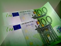 One hundred euros is good, but two hundred is better. A denomination of one hundred euros prevails over the design of the others. The whole secret in green color Royalty Free Stock Images