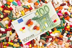 One hundred euros on many pills. As pharmacy profit concept Royalty Free Stock Photography