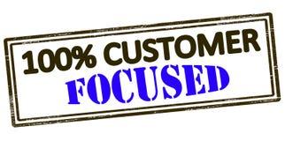 One hundred percent customer focused. Rubber stamp with text one hundred percent customer focused inside,  illustration Royalty Free Stock Images
