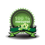 One hundred percent natural. Green label with small flowers and the text one hundred percent natural written inside the label Royalty Free Illustration