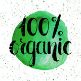 One hundred percent organic natural label. Hundred percent organic label. Handwritten calligraphy grunge inscription 100 percent organic on green watercolor Royalty Free Stock Photography