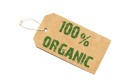 One hundred percent organic  sign- a paper price tag on a white Royalty Free Stock Photos