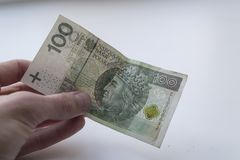 One hundred Polish zloty banknotes in hand. Closeup photo royalty free stock photo
