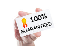 One hundred procent guaranteed. One hundred or 100 procent guaranteed concept card hold by hand isolated on white background Royalty Free Stock Photos