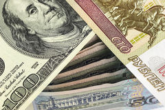 One hundred rubles, and a hundred dollars on Russian banknotes Royalty Free Stock Images