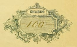 One Hundred Shares. Macro shot of antique stock certificate for 100 shares stock photos