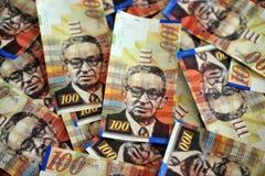 One Hundred Shekel Bills. One hundred Shekels notes are scattered randomly Stock Images