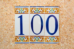 100 (one hundred) tile numbered. (door or house number Stock Images