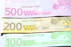 One hundred, two hundred and five hundred euro bills closeup. Shallow focus. Stock Photos