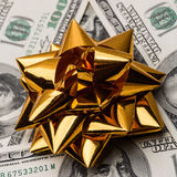 One hundred US dollars bills with holidays bow Royalty Free Stock Image