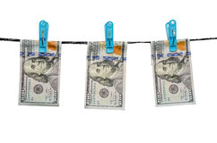 One hundred us dollars are drying on cord isolated Royalty Free Stock Photo