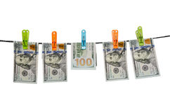 One hundred us dollars are drying on cord isolated Royalty Free Stock Photography