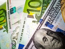 One hundred US dollars, 100 Euro and russian Rubles banknotes. Macro. Color image of money stock photo