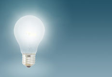 One Illuminated light bulb Royalty Free Stock Photos