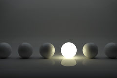 One illuminater ball among grey balls. One ball among grey balls in the row. concept 3D rendering image Stock Photos