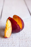 One incision juicy peach, closeup Royalty Free Stock Photos