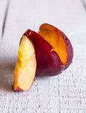One incision juicy peach, closeup, vertically Stock Photography