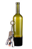 One incomplete bottle of wine and corkscrew Royalty Free Stock Images