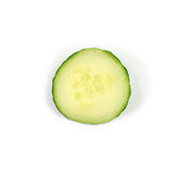 One individual cucumber slice. Isolated on white background Royalty Free Stock Image