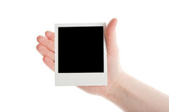 One instant photo in hand Royalty Free Stock Photos