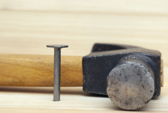 One iron nail and hammer Royalty Free Stock Image