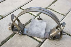 One iron trap on stone floor royalty free stock photo