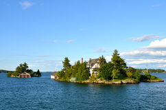 One Island in Thousand Islands Region in fall of New York State. Stock Photo