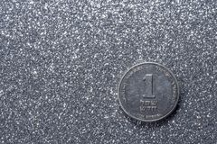 One Israeli New Sheqel. One shekel on a silvery background royalty free stock photography