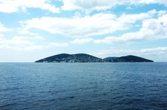 One of the Istanbul Islands under the cloudy sky Royalty Free Stock Photography