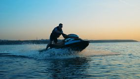 Man in a life jacket on a jet ski, close up.