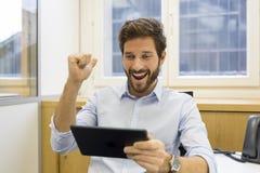 One joyful man holding digital tablet Stock Photos
