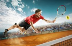 The one jumping player, caucasian fit man, playing tennis on the earthen court with spectators Stock Photos