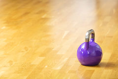 One kettlebell stands on the floor at fitness gym Royalty Free Stock Photography