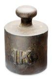 One Kilo. Old, rusty 1-kilogram-iron-weight, isolated on white stock photography