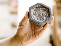 One Kilo Gram. A Hnad holding One kilogram weight stock images