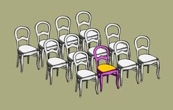 One of a kind. Group of identical chairs and one different Royalty Free Stock Image