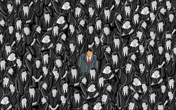 One of a kind. Man standing out from a crowd Stock Photo