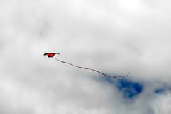 One Kite Flying over a Cloudy Sky Royalty Free Stock Photo